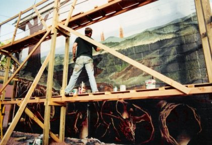 Michael Beenenga at work on an outdoor mural