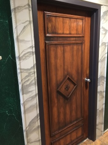 faux-wood-door-with-marble-framing