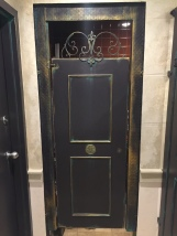 "Here a simple shower door is transformed into an aged Italian door, with ""years of character"" added to it."